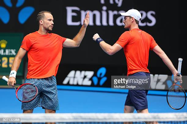 Bruno Soares of Brazil and Jamie Murray of Great Britain celebrate a point in their doubles semi finals match against Adrian Mannarino and Lucas...
