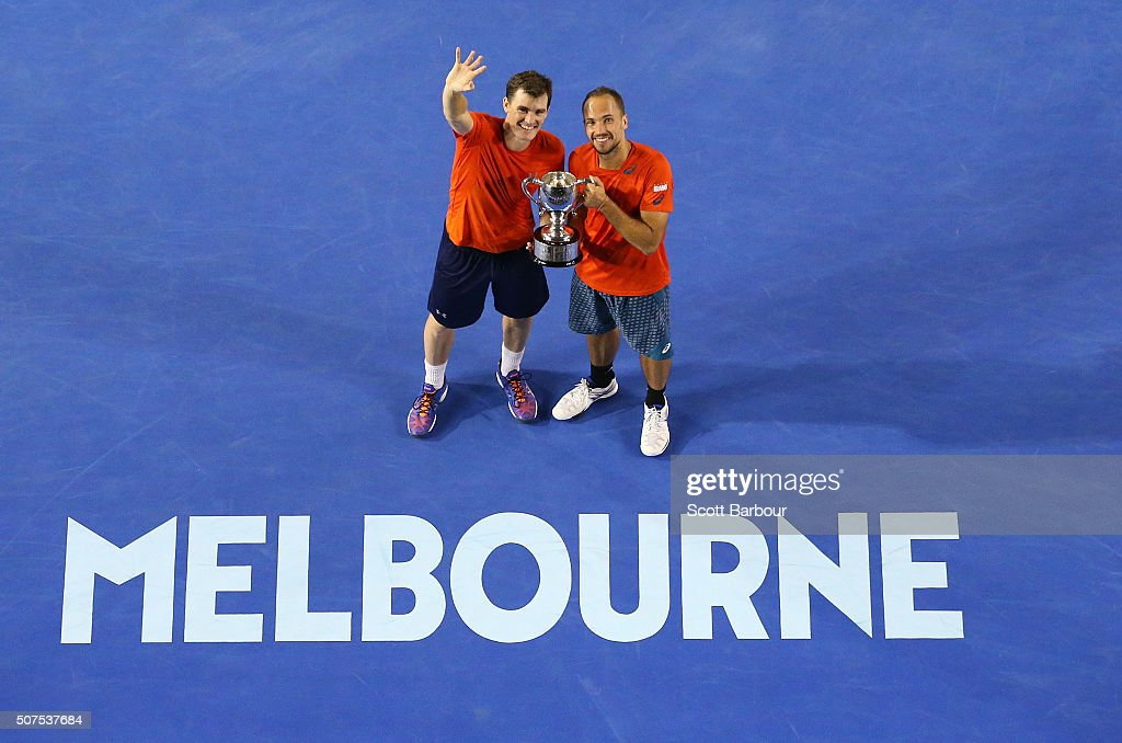 Bruno Soares of Brazil and Jamie Murray of Great Britain pose with the trophy after winning the Men's Doubles Final match against Daniel Nestor of Canada and Radek Stepanek of the Czech Republic during day 13 of the 2016 Australian Open at Melbourne Park on January 30, 2016 in Melbourne, Australia.