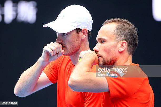 Bruno Soares of Brazil and Jamie Murray of Great Britain talk tactics in their doubles semi finals match against Adrian Mannarino and Lucas Pouille...
