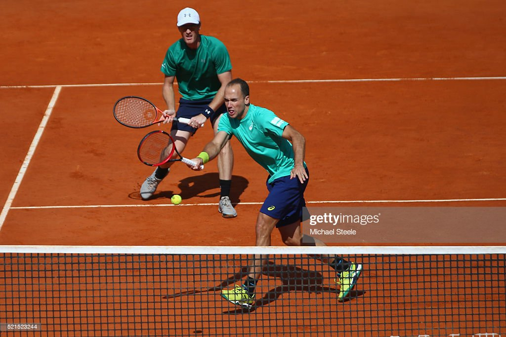 <a gi-track='captionPersonalityLinkClicked' href=/galleries/search?phrase=Bruno+Soares+-+Tennis+Player&family=editorial&specificpeople=11650044 ng-click='$event.stopPropagation()'>Bruno Soares</a> of Brazil plays a forehand return as doubles partner <a gi-track='captionPersonalityLinkClicked' href=/galleries/search?phrase=Jamie+Murray+-+Tennis+Player&family=editorial&specificpeople=4393751 ng-click='$event.stopPropagation()'>Jamie Murray</a> of Great Britain looks on during their semi final match against Ivan Dodig of Croatia and Marcelo Melo of Brail during the semi final match on day seven of the Monte Carlo Rolex Masters at Monte-Carlo Sporting Club on April 16, 2016 in Monte-Carlo, Monaco.