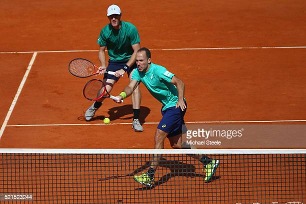 Bruno Soares of Brazil plays a forehand return as doubles partner Jamie Murray of Great Britain looks on during their semi final match against Ivan...