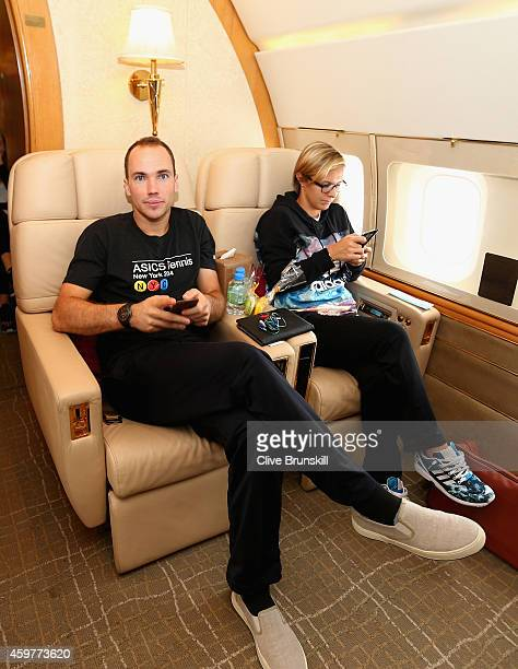 Bruno Soares of the Singapore Slammers and Kirsten Flipkens of the Manila Mavericks on a private jet from Manila to Singapore prior to the CocaCola...