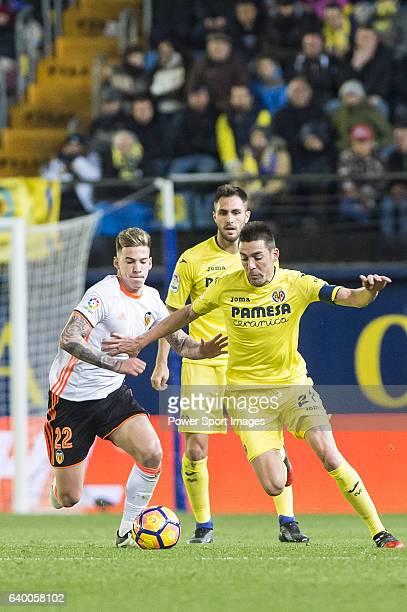 Bruno Soriano Llido of Villarreal CF battles for the ball with Santiago Mina Lorenzo Santi Mina of Valencia CF during their La Liga match between...