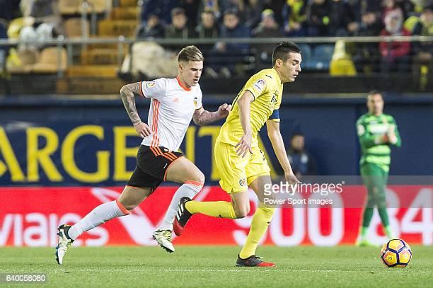 Bruno Soriano Llido of Villarreal CF is followed by Santiago Mina Lorenzo Santi Mina of Valencia CF during their La Liga match between Villarreal CF...