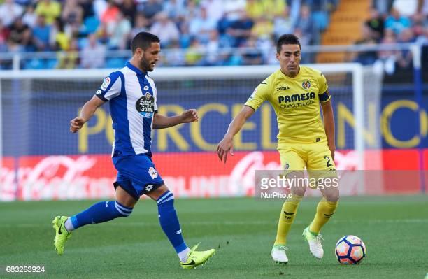 Bruno Soriano of Villarreal CF and Florin Andone of Deportivo de la Coruna during their La Liga match between Villarreal CF and Deportivo de la...