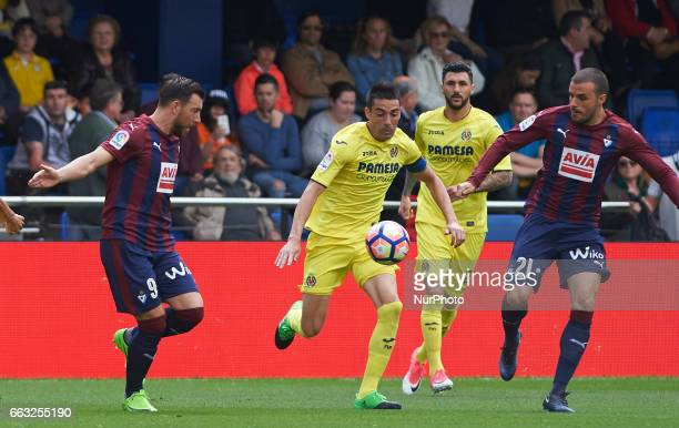 Bruno Soriano of Villarreal CF and Sergi Enrich and Pedro Leon of SD Eibar during their La Liga match between Villarreal CF and SD Eibar at the...