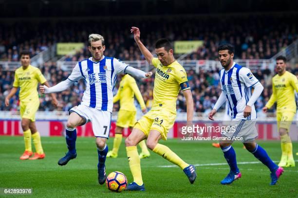 Bruno Soriano of Villarreal CF duels for the ball with Juan Miguel Jimenez 'Juanmi' of Real Sociedad during the La Liga match between Real Sociedad...