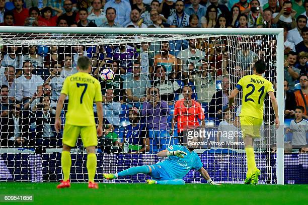 Bruno Soriano of Villarreal CF scores their opening goal from a penalty shot against goalkeeper Francisco alias Kiko Casilla of Real Madrid CF during...