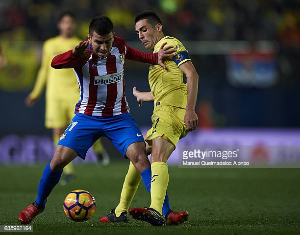 Bruno Soriano of Villarreal competes for the ball with Angel Correa of Atletico de Madrid during the La Liga match between Villarreal CF and Atletico...
