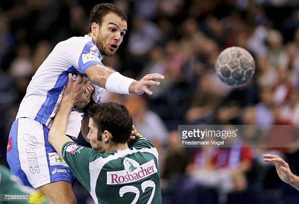 Bruno Souza of Hamburg tussles for the ball with Gregor Werum of Wetzlar during the Bundesliga game between HSV Handball and HSG Wetzlar at the Color...