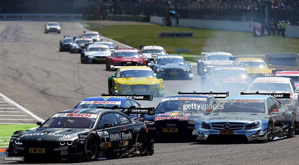 Bruno Spengler of Canada and BMW Team Schnitzer drives into the first corner during the first round of the DTM 2013 German Touring Car Championship at Hockenheimring on May 5, 2013 in Hockenheim, Germany.