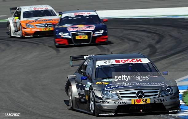 Bruno Spengler of Canada and Mercedes Benz Bank AMG Mercedes takes an early lead of Mattias Ekstroem of Swden and Audi Sport Team Abt Sportsline and...