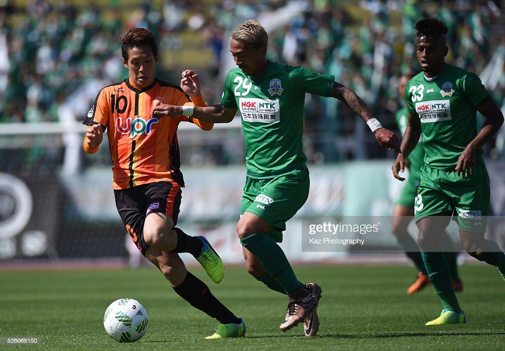 Bruno Suzuki of FC Gifu and Yoshihiro Shoji of Renofa Yamaguchi compete for the ball during the J.League match between FC Gifu and Renofa Yamaguchi at the Nagaragawa Stadium on April 29, 2016 in Nagoya, Japan.
