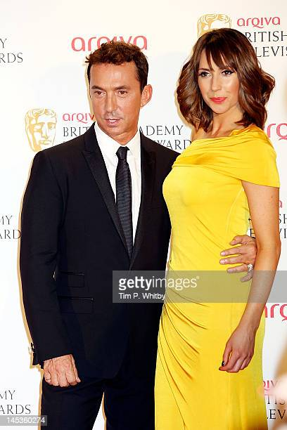 Bruno Tonioli and Alex Jones poses in front of the winners boards at The 2012 Arqiva British Academy Television Awards at the Royal Festival Hall on...