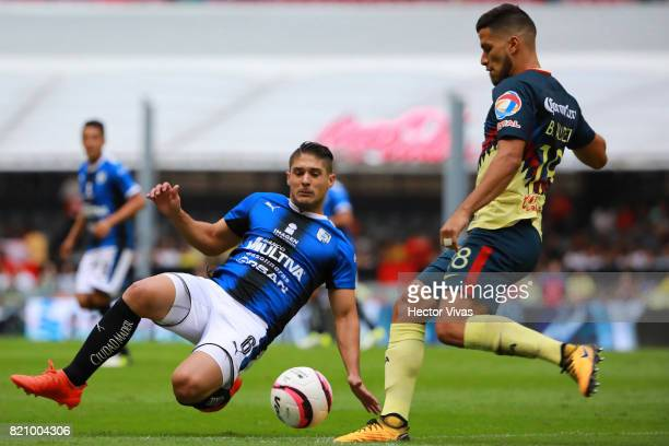 Bruno Valdez of America tries to avoid the slide by Javier Guemez of Queretaro during the 1st round match between America and Queretaro as part of...