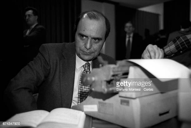 Bruno Vespa sits at a typewriter while preparing an article during the political committee of the Communist Refoundation Party on January 1994 in...