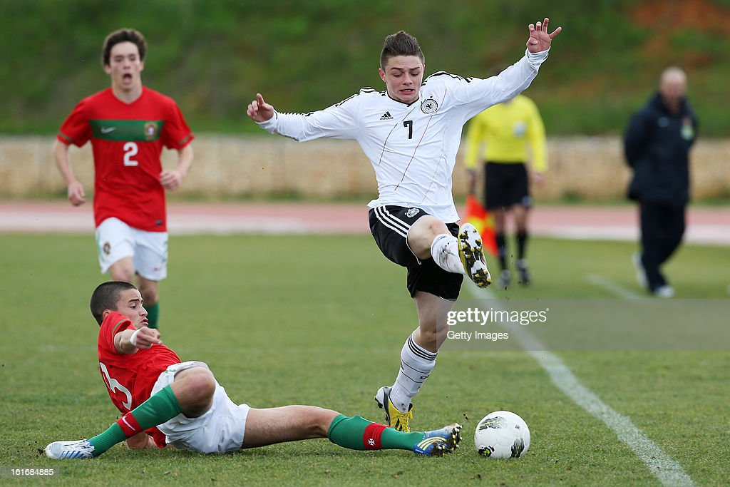 Bruno Wilson (L) of Portugal challenges Maurice Multhaup of Germany during the Under17 Algarve Youth Cup match between U17 Portugal and U17 Germany at the Stadium Bela Vista on February 12, 2013 in Parchal, Portugal.