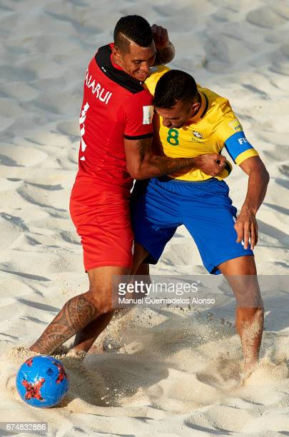 Bruno Xavier of Brazil competes for the ball with Heimanu Taiarui of Tahiti during the FIFA Beach Soccer World Cup Bahamas 2017 group D match between...