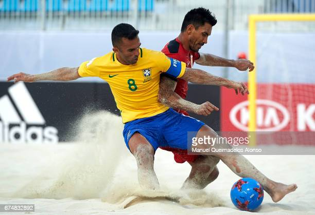 Bruno Xavier of Brazil competes for the ball with Teva Zaveroni of Tahiti during the FIFA Beach Soccer World Cup Bahamas 2017 group D match between...