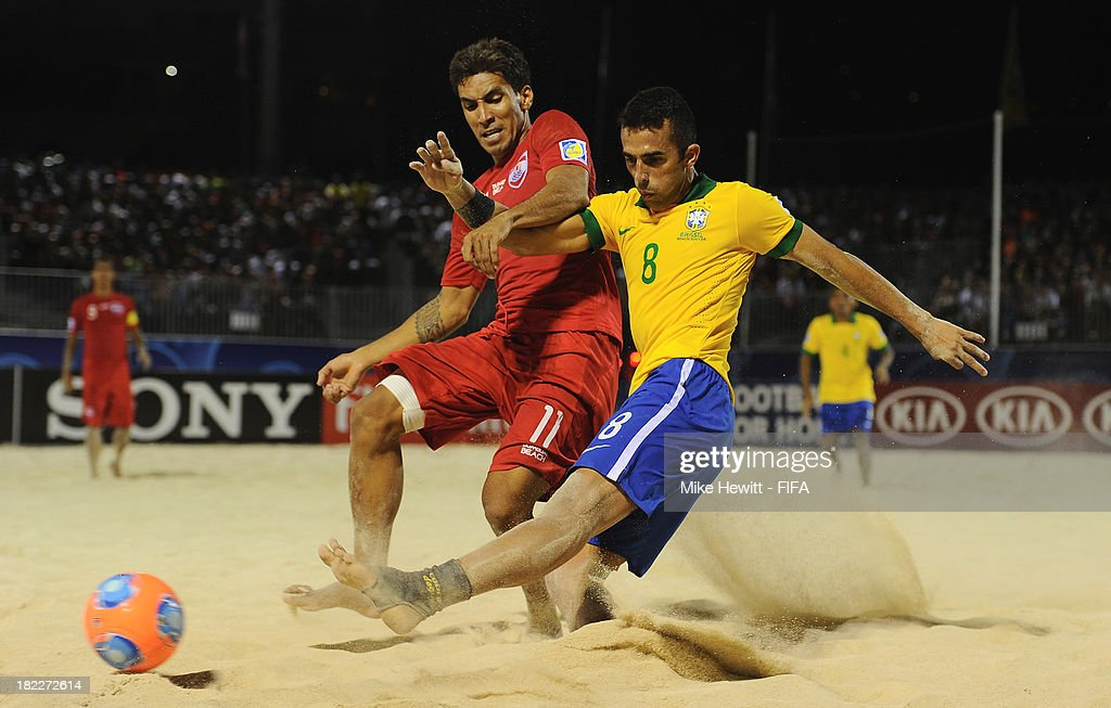 <a gi-track='captionPersonalityLinkClicked' href=/galleries/search?phrase=Bruno+Xavier&family=editorial&specificpeople=8674132 ng-click='$event.stopPropagation()'>Bruno Xavier</a> of Brazil shoots as Teva Zaveroni of Tahiti challenges during the FIFA Beach Soccer World Cup Tahiti 2013 3rd Place Playoff match between Brazil and Tahiti at the Tahua To'ata Stadium on September 28, 2013 in Papeete, French Polynesia.
