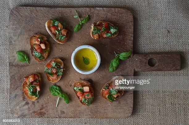 Bruschetta on rustic chopping board