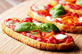 'Italian bruschetta with tomato, mozzarella and basil'