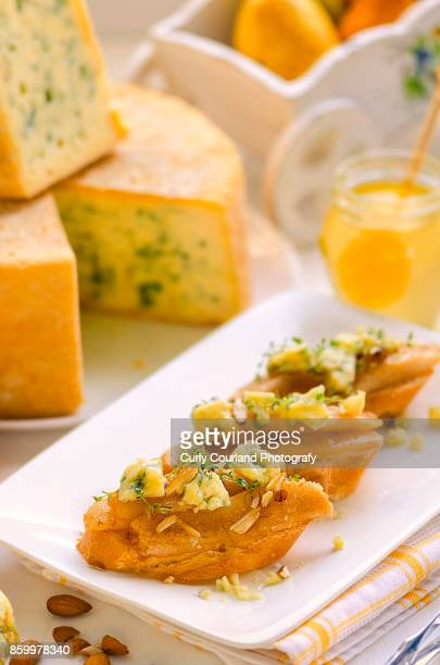 Bruschetta with blue cheese, almonds, catamelized pears, honey and thyme