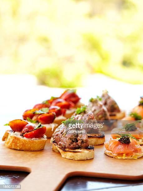 Bruschetta with cheese, tomatoes, foie gras, and wild salmon