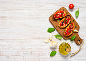 Italian Cuisine Food Bruschetta Antipasto with Basil and Tomato in Copy Space Top View