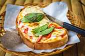 Italian bruschetta with tomatoes, basil and cheese on grilled crusty bread