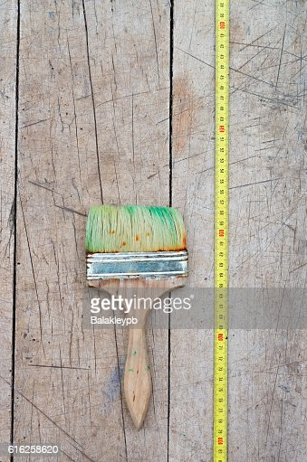 brush and tape measure : Stock Photo