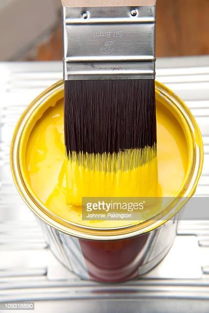 Brush and yellow paint