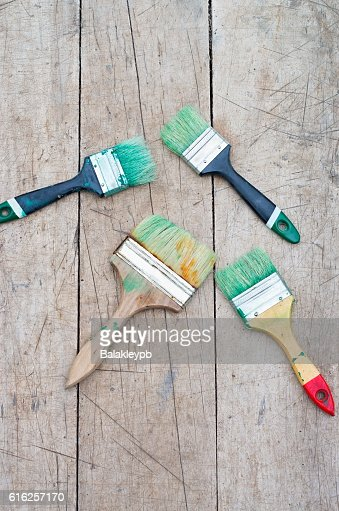 brush in green paint : Stock Photo