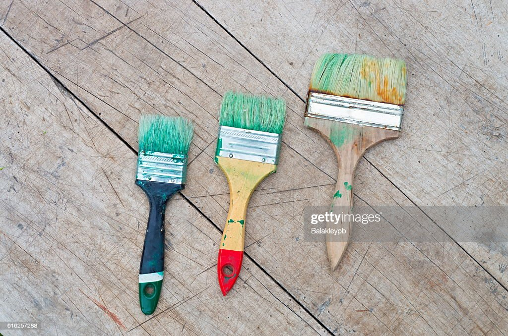 brush in green paint : Foto de stock