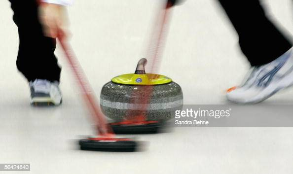 Brushes sweep the ice in front of a stone during the European Curling Championship 2005 at the Olympic Ice Sports Centre on December 13 2005 in...