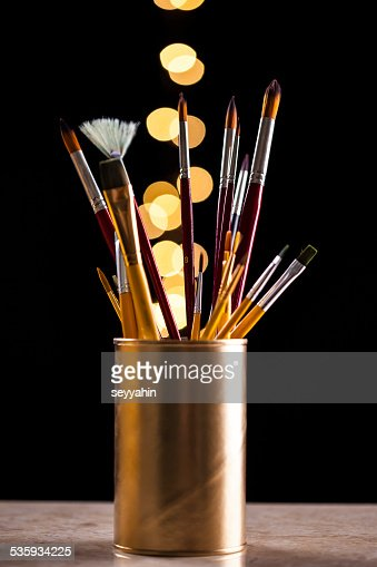 brushes with gold bokeh : Stock Photo
