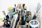Brushes with oil paint in artist studio