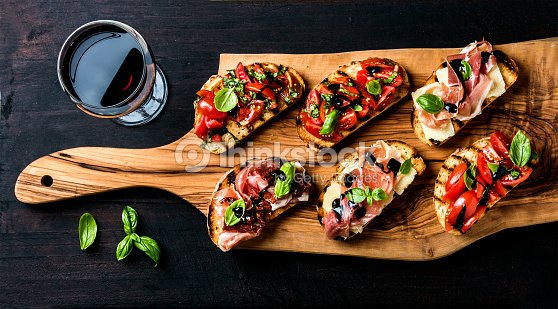 Brushetta set and glass of red wine. Small sandwiches with : Stock Photo