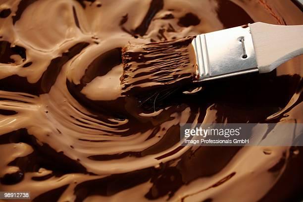 Brushing melted chocolate, close-up