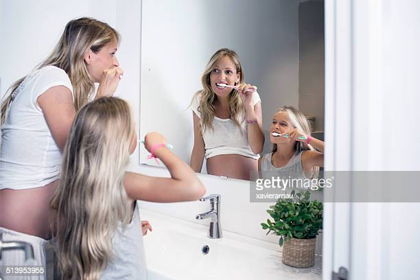 Brushing their teeth