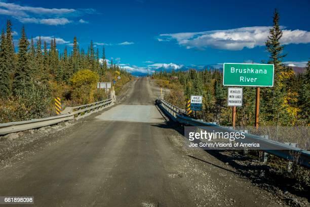 Brushnaka River bridge offers views of Alaskan Range Denali Highway Route 8 Alaska