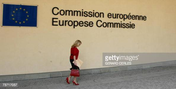 A woman walks in front of the entrance of the European Commission Berlaymont builing at the EU Headquarters in Brussels 27 March 2007 Police in...