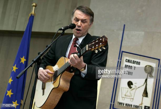 Belgian singer and UNICEF ambassador Salvatore Adamo performs during a press conference 24 May 2006 at the EU Headquarters in Brussels ahead of...