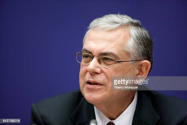 Brussels Belgium December 9 2011 Greek Prime Minister Lukas PAPADEMOS speaks during a media conference at the end of an EU summit The president of...
