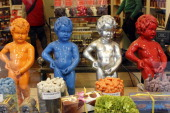 Brussels Belgium Europe Grand Platz Manneken Pis statues in chocolate shop window