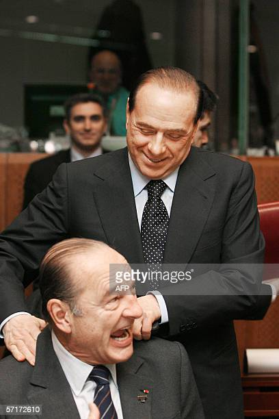 Italian Prime Minister Silvio Berlusconi jokes around with French President Jacques Chirac prior to the second day of talks at a European Summit 24...