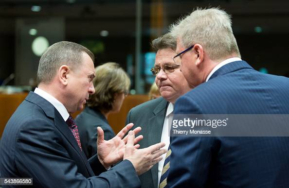 Brussels Belgium July 22 2014 Belarusian Minister of Foreign Affairs Vladimir MAKEY is talking with the Lithuanian Minister of Foreign Affairs Linas...