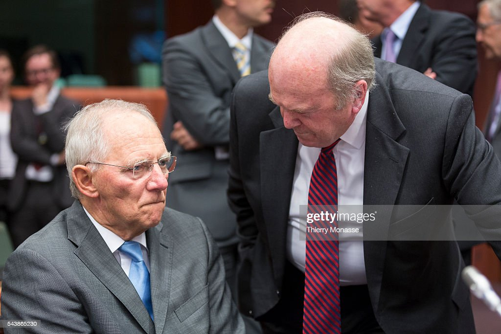 Brussels Belgium July 7 2014 German Minister of Finance Wolfgang SCHÄUBLE is talking with the Irish Minister for Finance Michael NOONAN prior the...