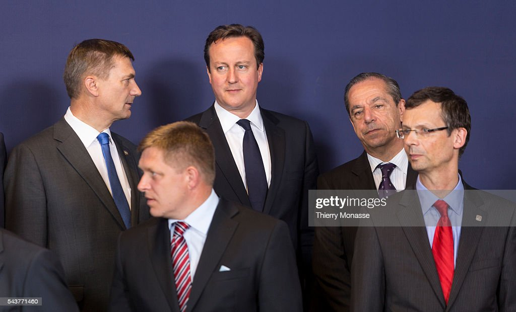 Brussels Belgium June 28 2012 Left to Right Estonian Prime Minister Andrus Ansip talks with the Slovak Prime Minister Robert Fico the British Prime...