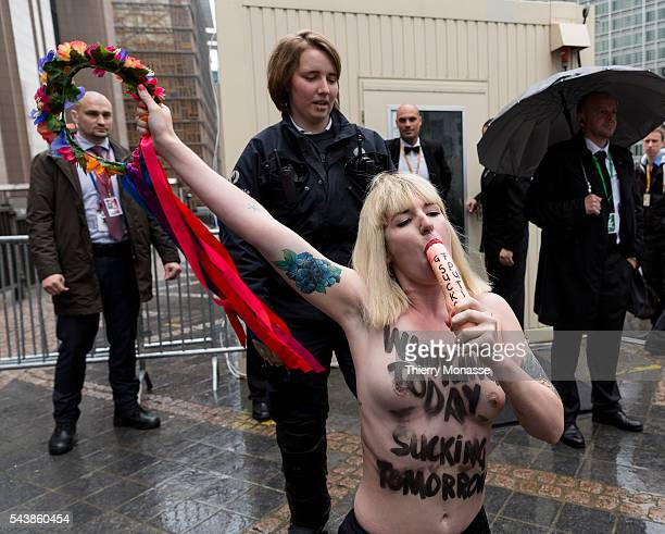 Brussels Belgium June 4 2014 Femen activist perform during a protest ahead of the G7 Summit in front the EU Council headquarters